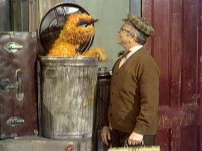 An Orange Grouch and a Green Grover