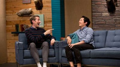 Steven Yeun Wears Rolled Up Black Jeans & No Socks
