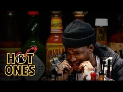 Curren$y Talks Munchies, Industry Games, and Rap Dogs While Eating Spicy Wings